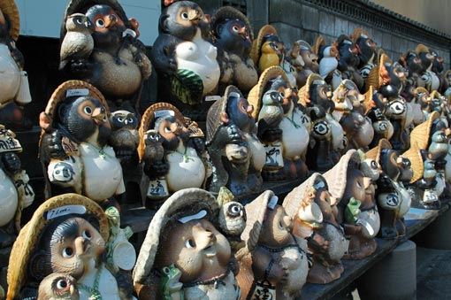 Army of tanuki figures for sale
